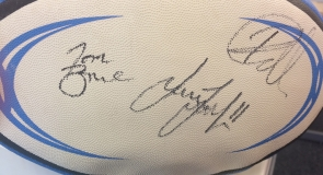 A rugby ball memorabilia signed by Leeds Rhinos squad