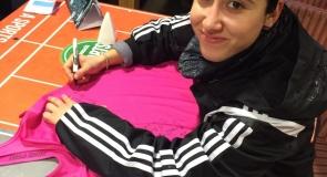 Tottenham Hotspurs player, Tanvie Hans signing sports t-shirt memorabilia to LMP