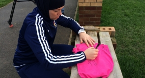 Former rounders international, Dana Abdulkarim signing sports t-shirt memorabilia to LMP