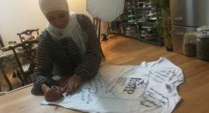 Chef Manal Alalem signing LMP t-shirt