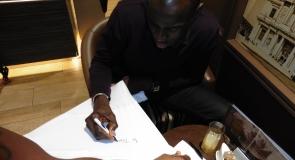 Former footballer, Mamady Sidibé signing LMP t-shirt