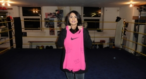 Britain's first female Muslim boxer, Ambreen Sadiq with a signed sports t-shirt to LMP